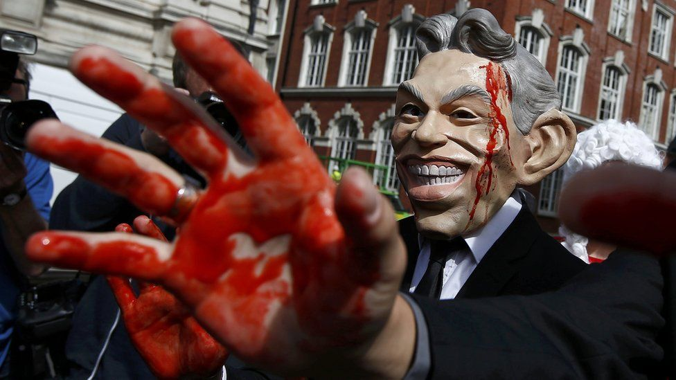 A demonstrator wearing a mask to impersonate Tony Blair protests before the release of the Chilcot report