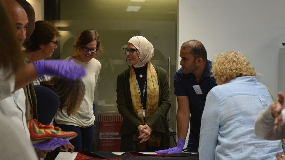 Collections officer Rana Ibrahim and volunteers welcome visitors to the Pitt Rivers Museum research space