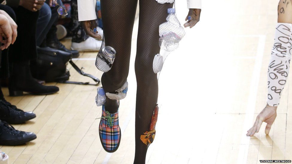 Plastic bottles and cans were trapped in tights as part of Westwood's environmental message