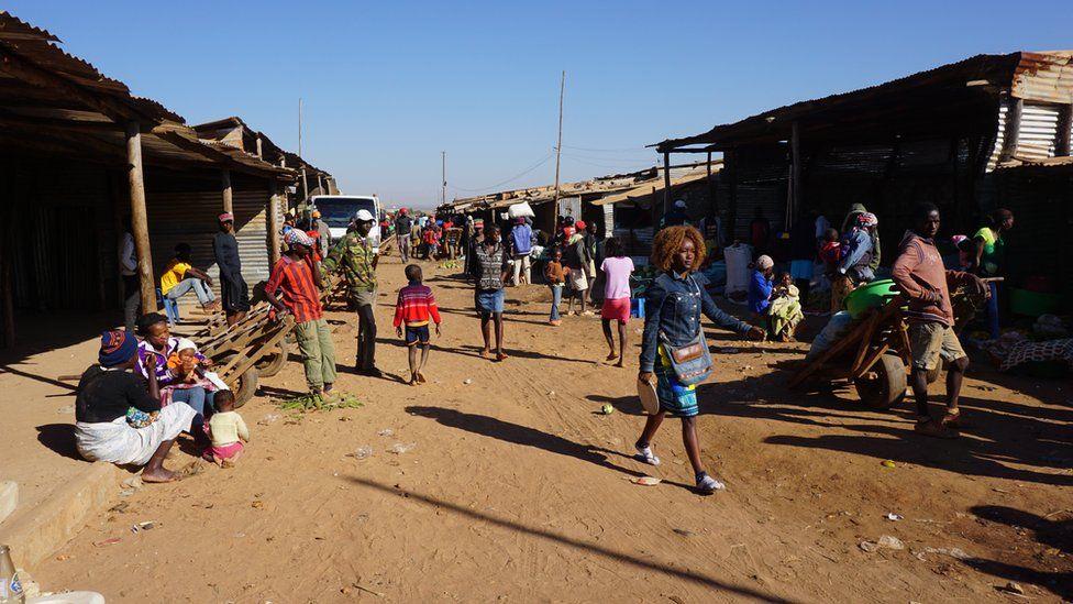 Bushmeat market, people walking, in Angola June 2016