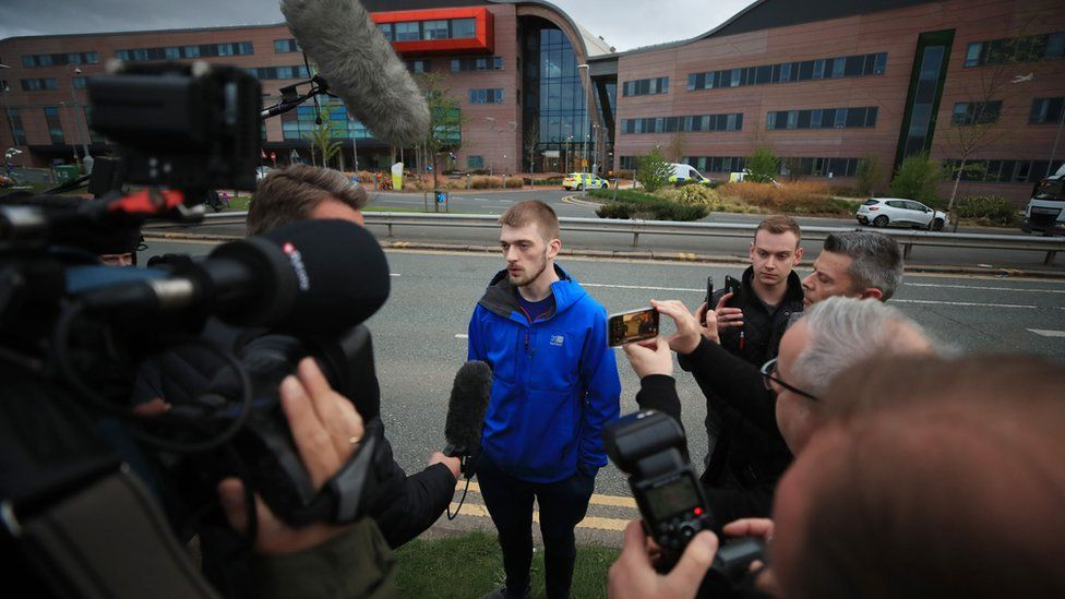 Tom Evans with reporters