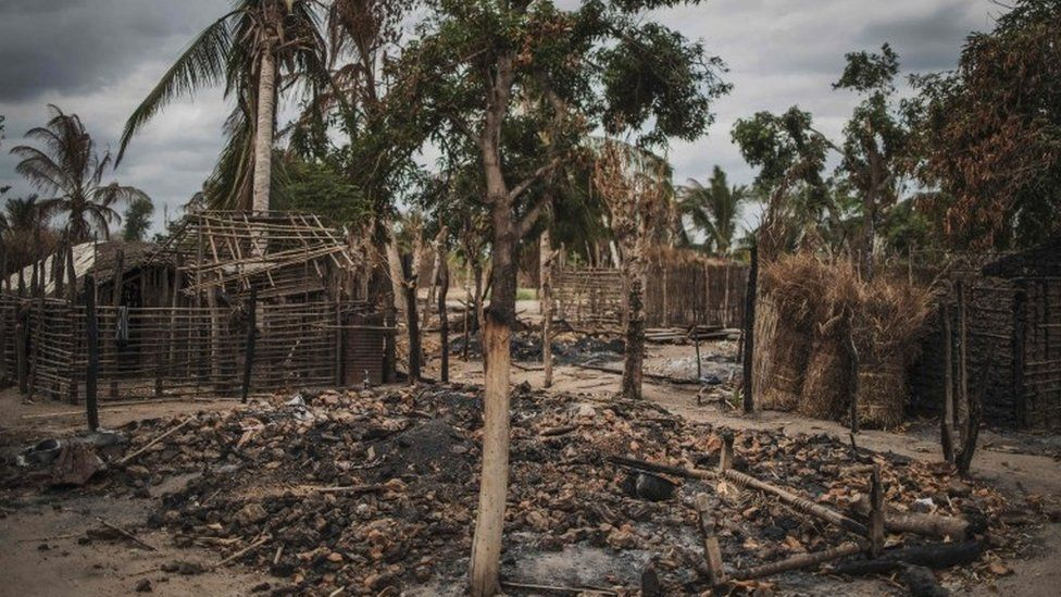 In this file photo taken on August 24, 2019 The remains of a burned and destroyed home is seen in the recently attacked village of Aldeia da Paz outside Macomia