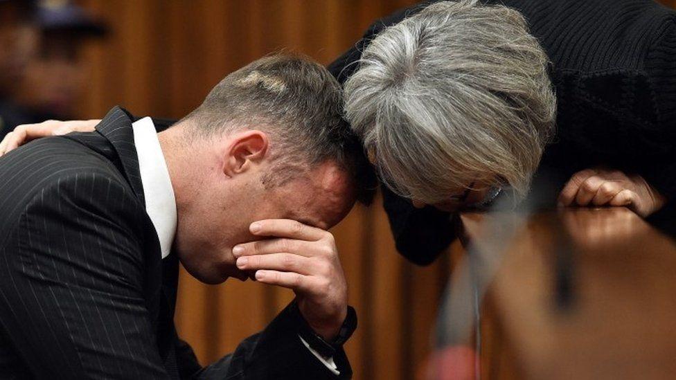 Pistorius being comforted in court