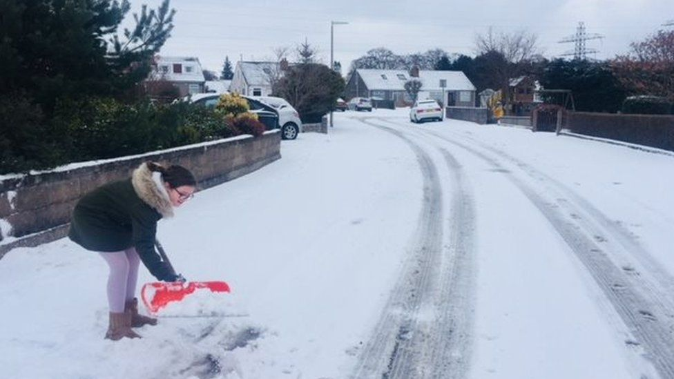Poppy Banks clearing snow in Aberdeen