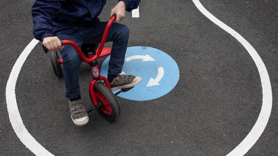 Child riding on a tricycle