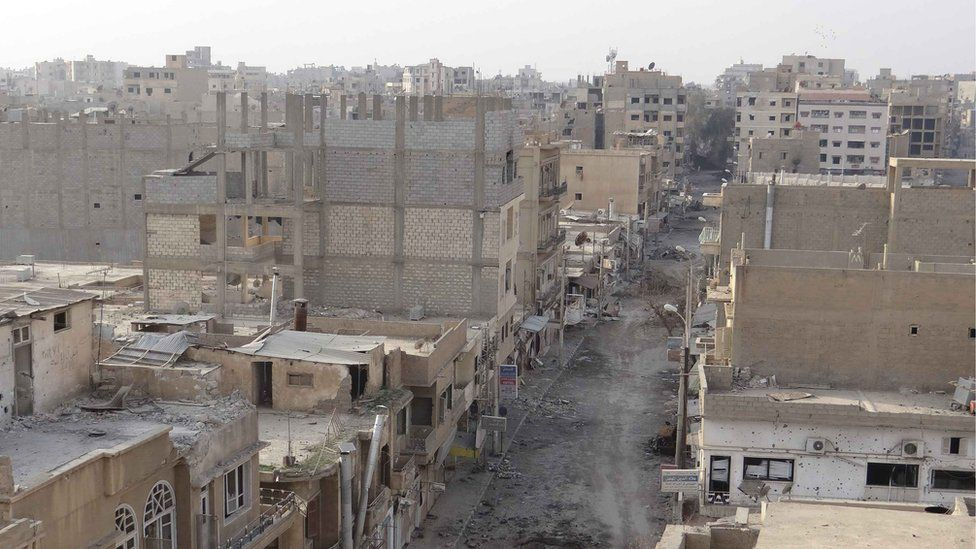 Shattered buildings in Deir al-Zour, January 2013
