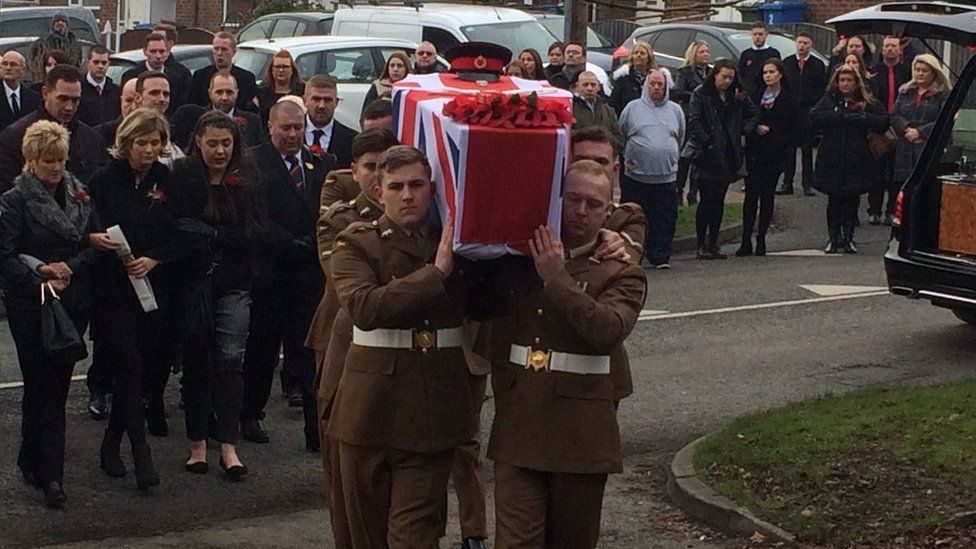 The coffin of L/Cpl Scott Hetherington carried by fellow members of his battalion.