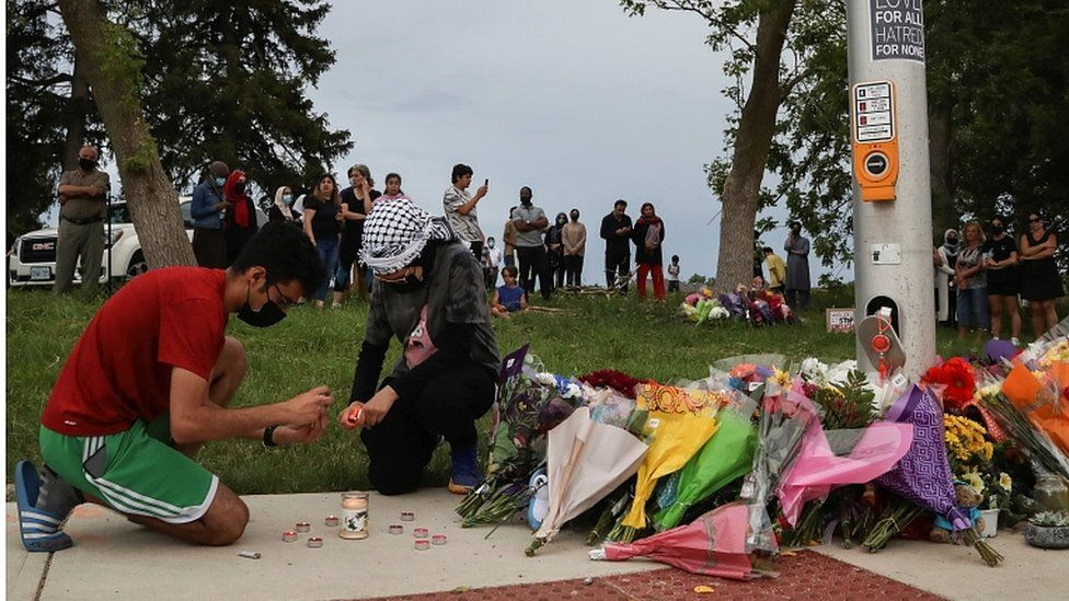 People light candles at a makeshift memorial in London, Ontario, Canada June 7, 202