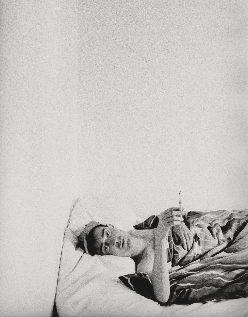 Stephen Linard lies in bed, c.1982–83