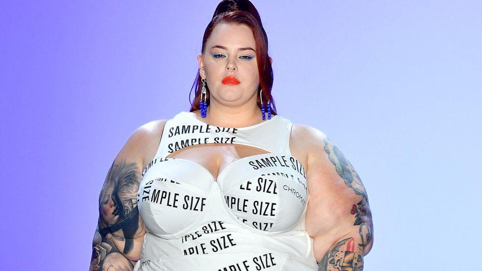 Tess walking at New York Fashion Week.