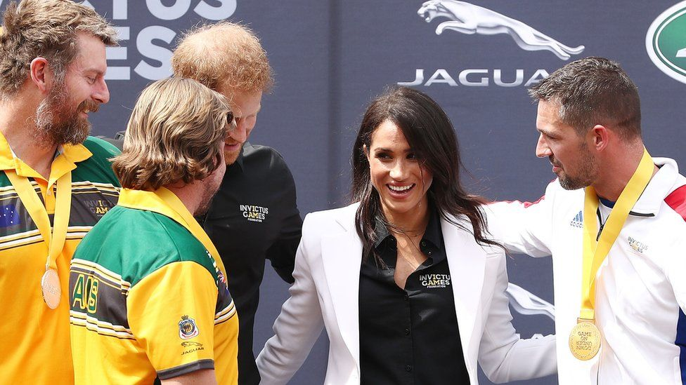 Prince Harry and Meghan hand out the first medals of this year's Invictus Games