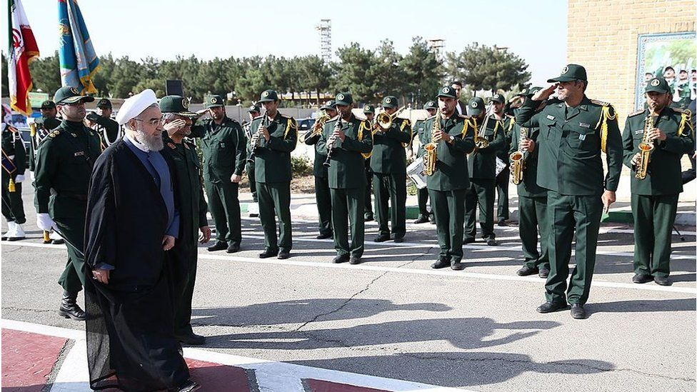 Iranian President Hassan Rouhani (L) attends the 21st Nationwide Assembly of the Islamic Revolution Guards Corps (IRGC) Commanders in Tehran, Iran on September 15, 2015.