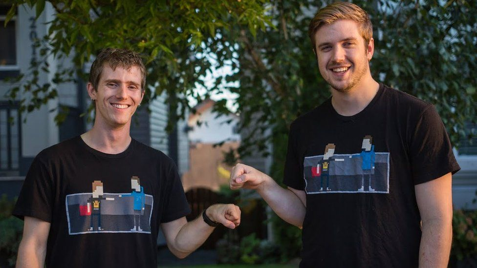 Linus Sebastian and Luke Lafreniere fist bump looking at the camera, wearing matching t-shirts