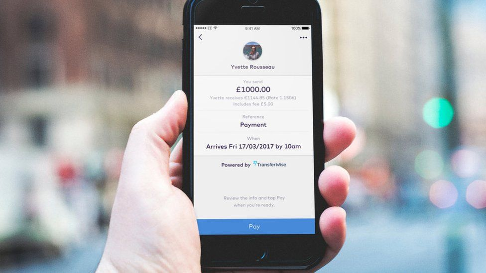 Mobile phone showing TransferWise money transaction