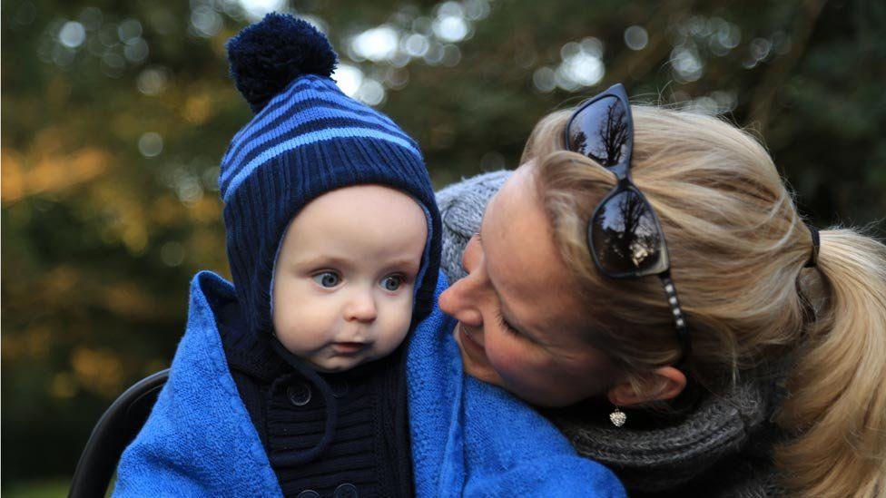 Alexandra Vanotti smiling at her child