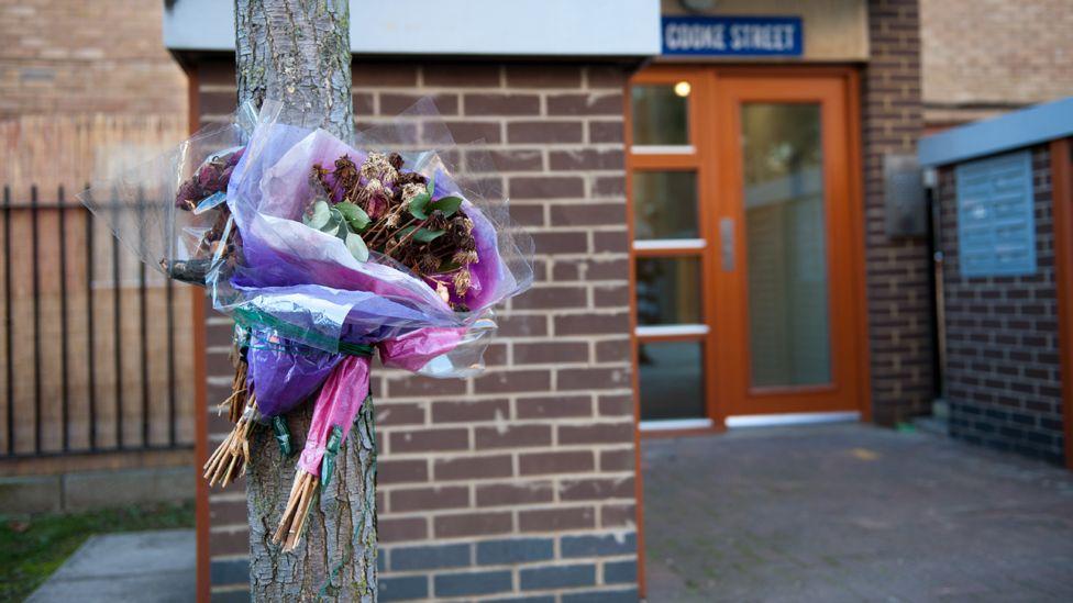 Flowers left outside Stephen Port's flat