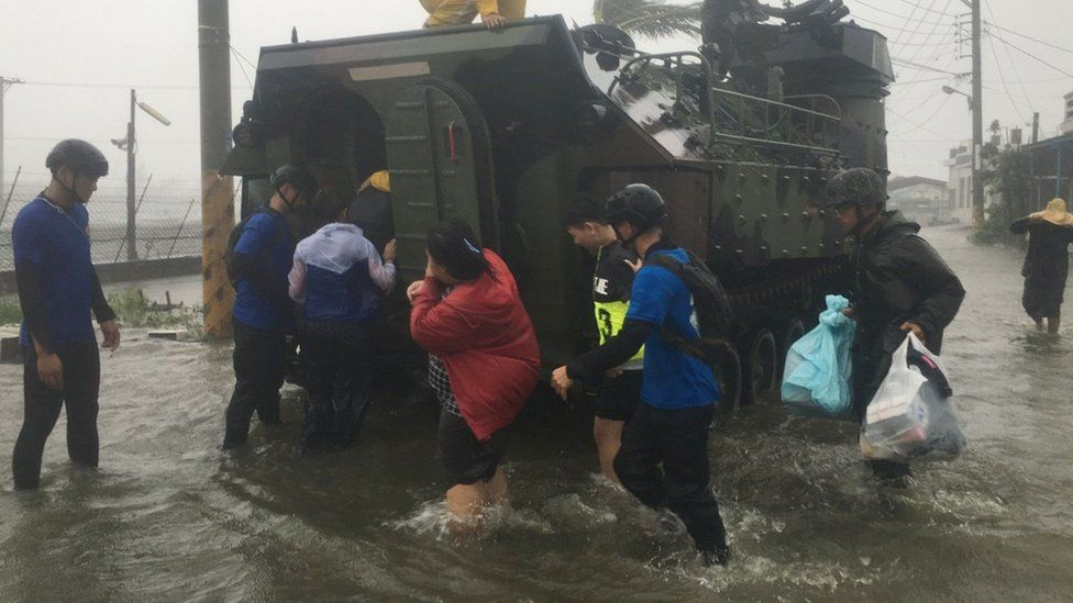 Photo shows residents affected by typhoon Meranti being evacuated on a military armoured vehicle in southern Pingtung county on September 14, 2016