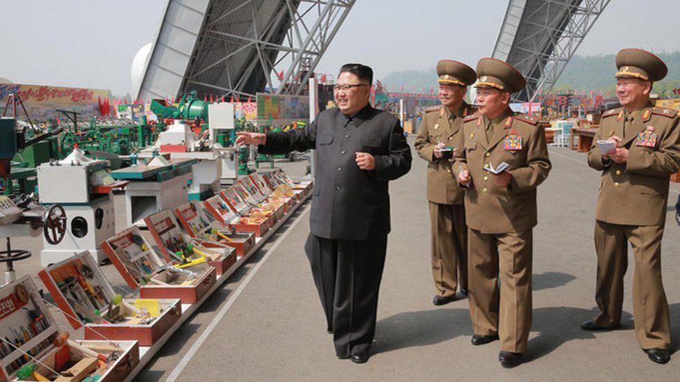 Kim Jong-un inspects goods at an exhibition in Pyongyang