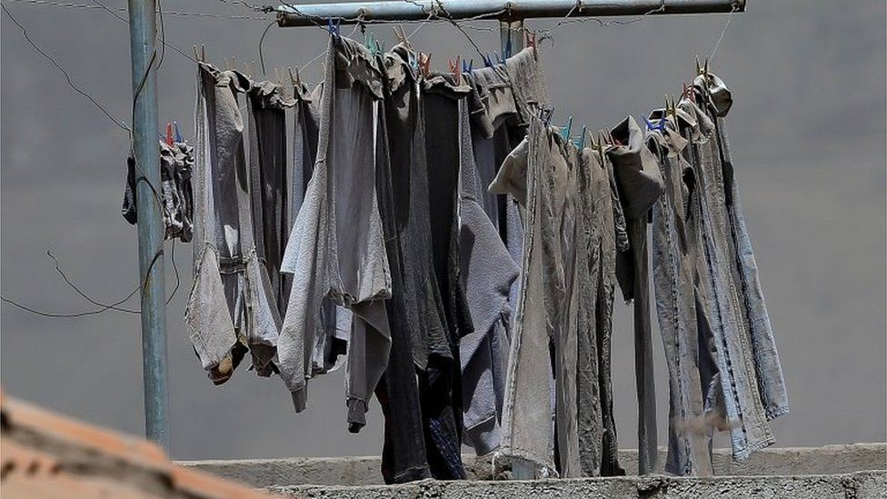 View of ash from the Sangay volcano on jeans hanging on a clothesline in the town of Alausi, in the province of Chimborazo, Ecuador, 20 September 2020.