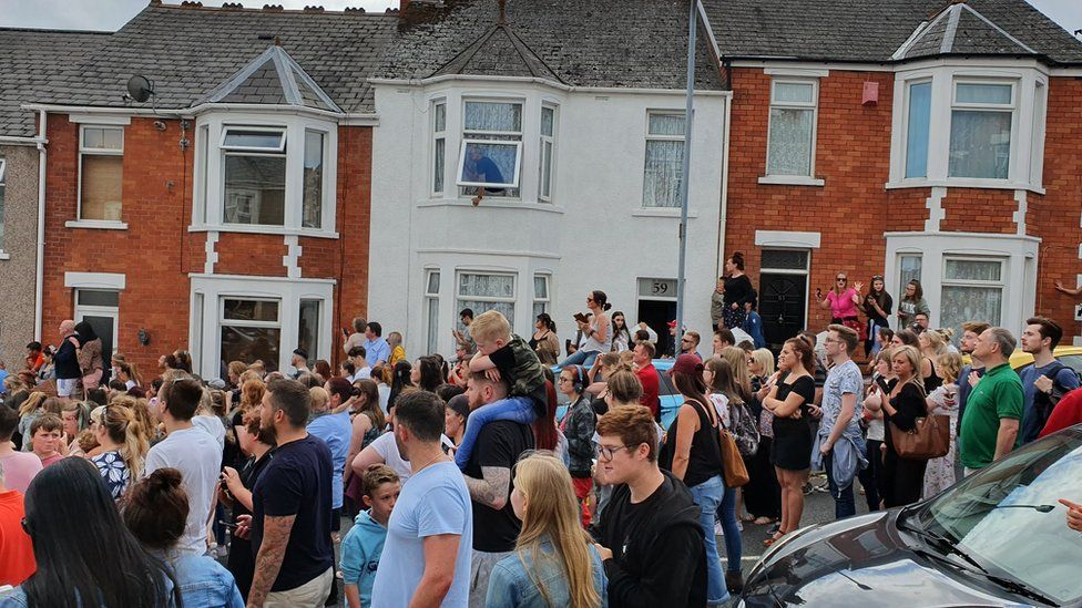 A crowd of people in the street where Gavin and Stacey is filmed