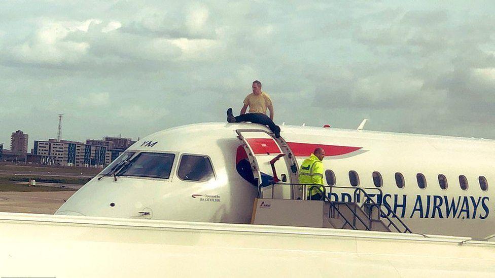 James Brown sitting on plane