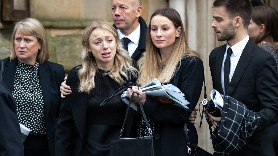 Leanne O'Brien (second from left) at the funeral service for her boyfriend