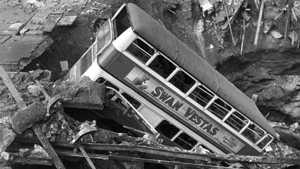 Bus in bomb crater