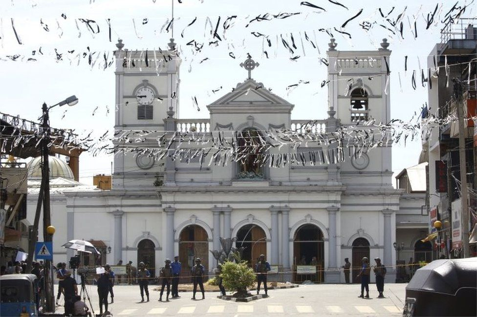White bunting being in front of St Anthony's Church as the city prepares for the funerals of the blast victims in Kochchikade, Colombo, Sri Lanka, 22 April 2019.
