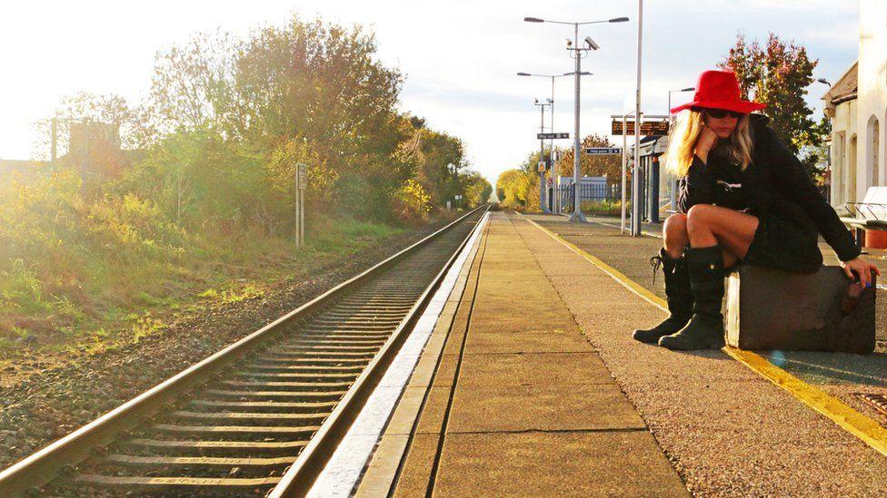 Woman at railway station