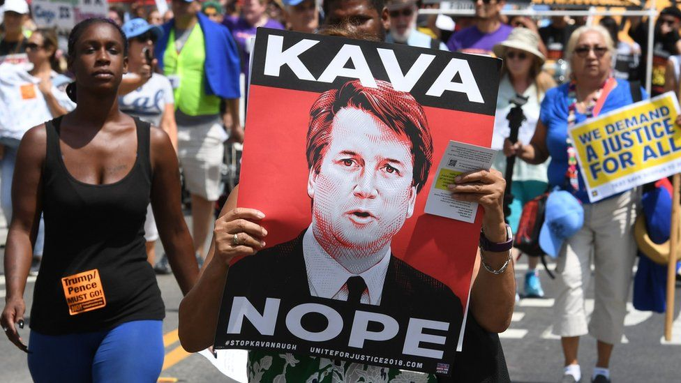 "Demonstrators march through the city streets during the ""Unite For Justice"" rally in protest of judge Brett Kavanaugh""s confirmation"