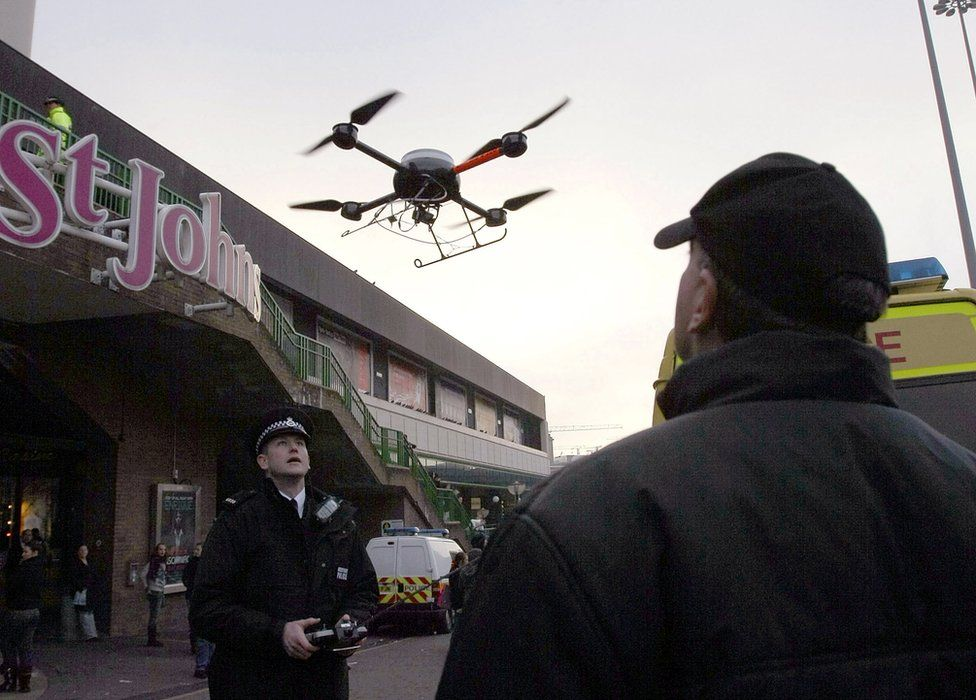 Police officer using a drone in Liverpool in December 2007