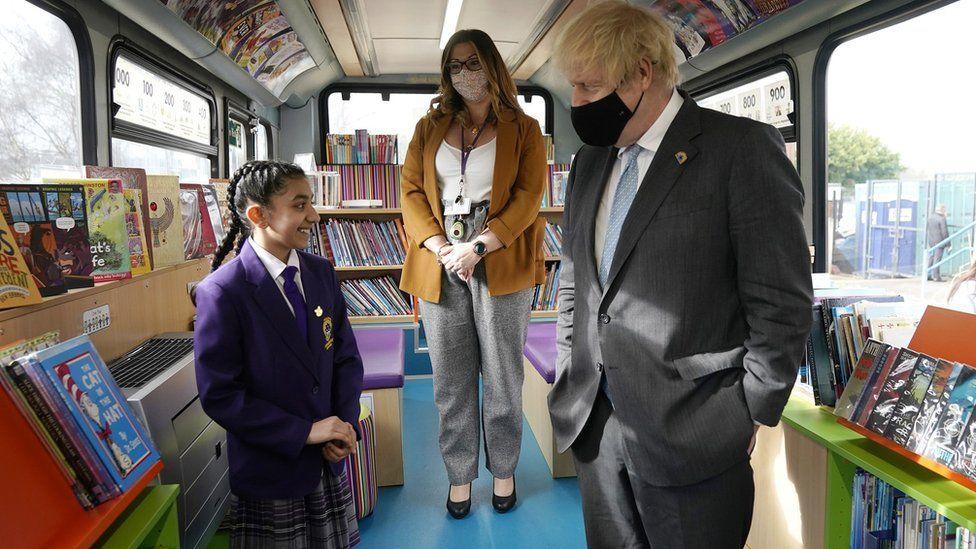 Boris Johnson on a school bus library