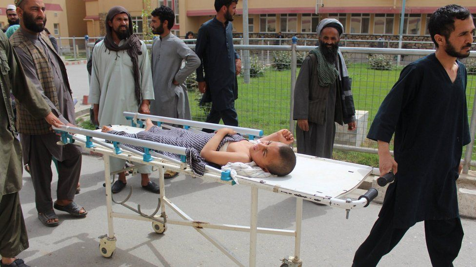 An Afghan child receives treatment at a hospital after Monday's airstrike in Kunduz province, Afghanistan April 3, 2018.