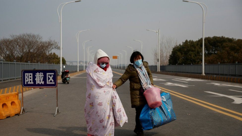 Mother and daughter at checkpoint