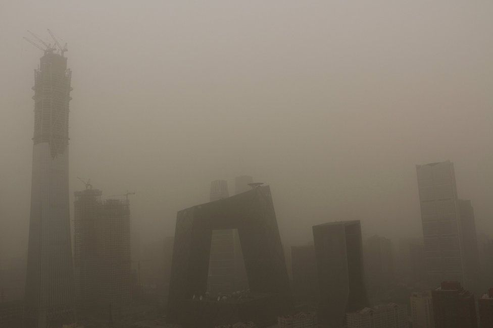 Buildings are seen during a dust storm in Beijing, China, 4 May 2017