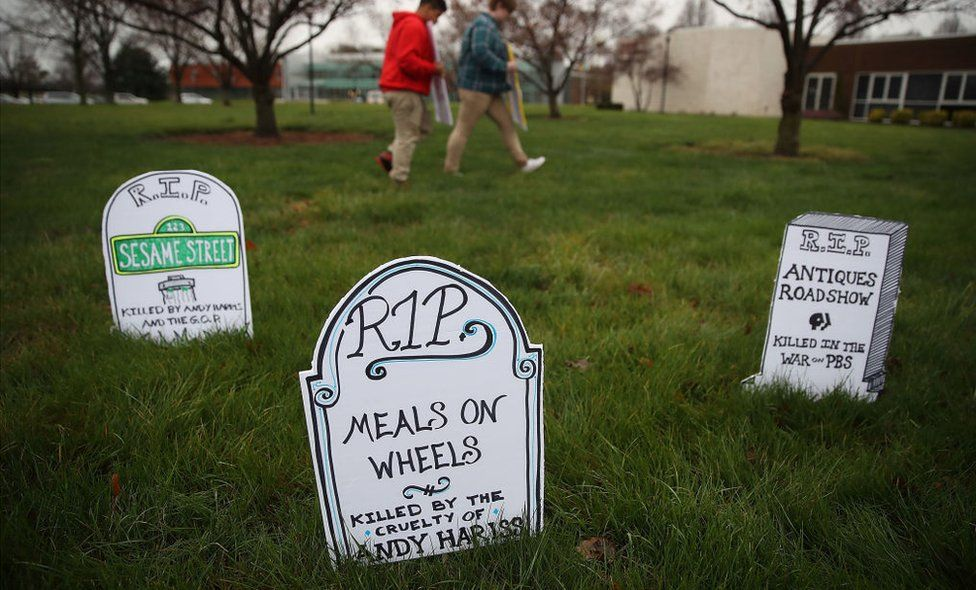 Protesters at a Republican congressman's town hall meeting laid out gravestones for Meal on Wheels and popular public broadcasting programmes