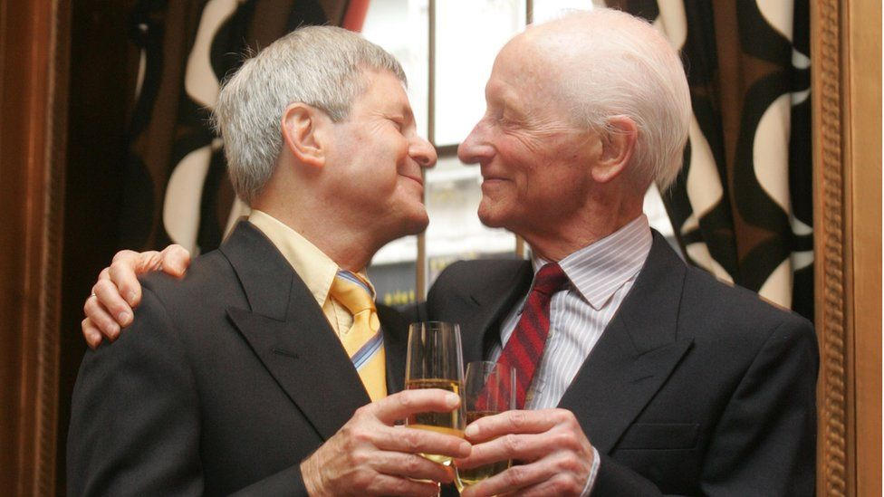 Percy Steven shares champagne with Roger Lockyer on their wedding day