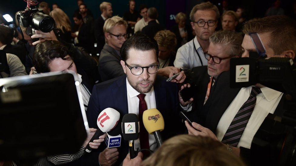 Jimmie Akesson of the Sweden Democrats swarmed with press after a party leader debate on 7 September 2018