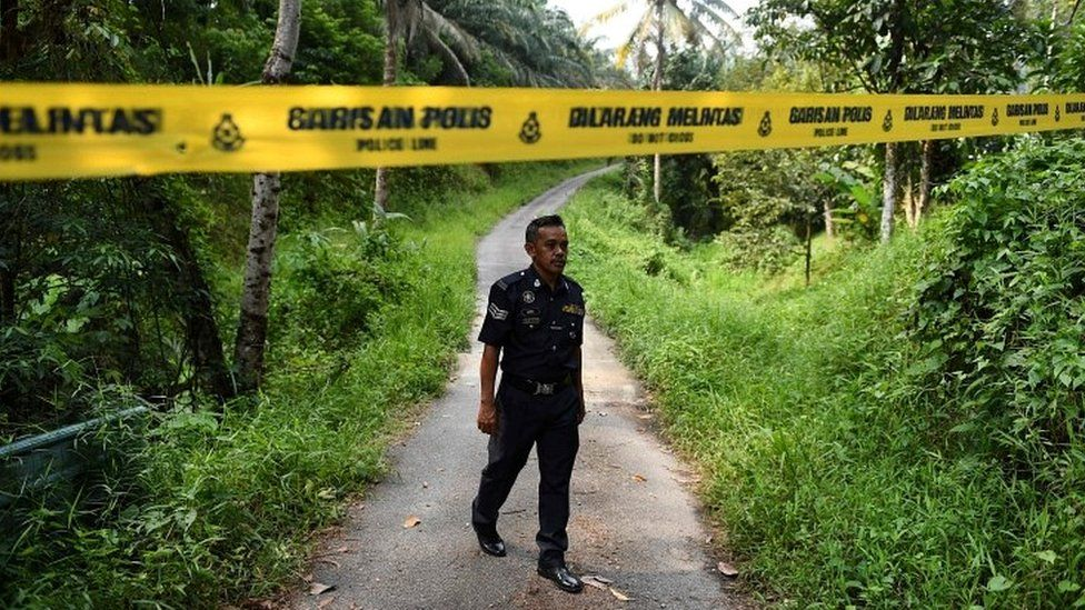 A Malaysian police officer near the Dusun resort