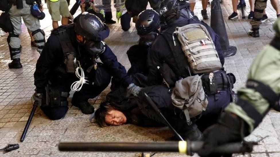 Police detain a demonstrator in Hong Kong. Photo: 31 August 2019