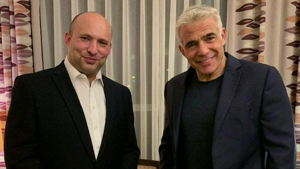 The right-wing Yamina party's Naftali Bennett and Yair Lapid, leader of the centrist Yesh Atid party, after reaching an agreement