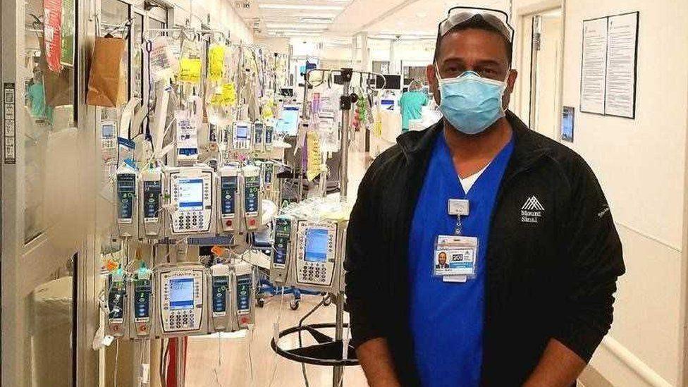 Rocky Walker, wearing a facemask in a Mount Sinai hospital hallway