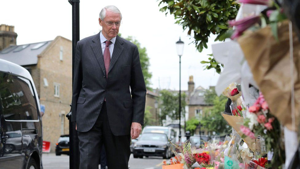 Sir Martin Moore-Bick looking at tributes left near Grenfell Tower