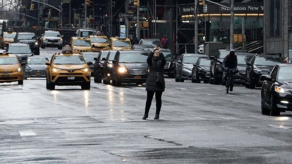 A woman takes a picture on New York's Times Square. File photo