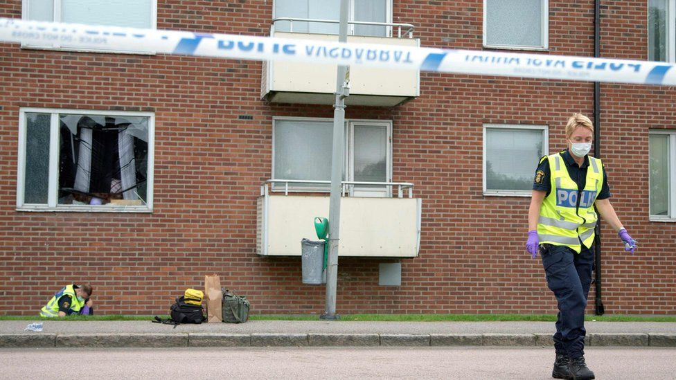 Forensic police outside the flat in the Biskopsgarten area of Gothenburg