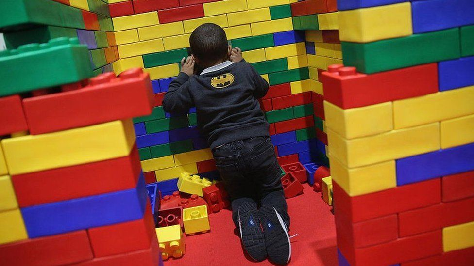 child with giant lego