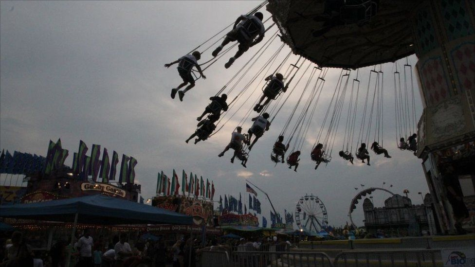 People on a fairground ride in Maryland, US.