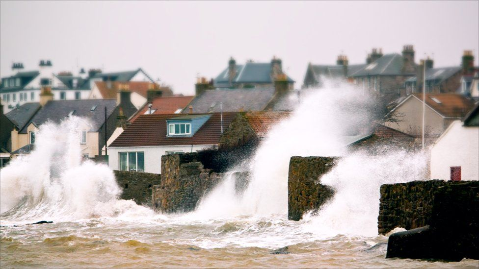 Rough seas battering the sea walls at Anstruther, Fife