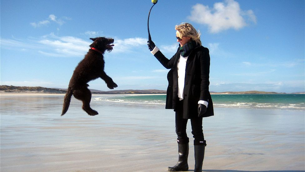 Emma and dog Enzo on the beach in North Uist