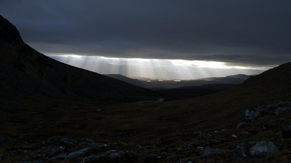 Sunlight breaking through clouds over Seana Bhraigh